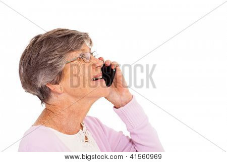 cheerful elderly lady talking on smart phone isolated on white