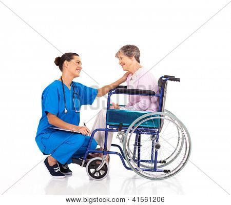 friendly nurse talking to disabled senior patient