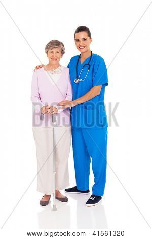 beautiful young nurse and senior woman isolated on white
