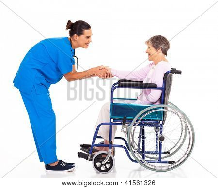 friendly nurse greeting disabled senior patient