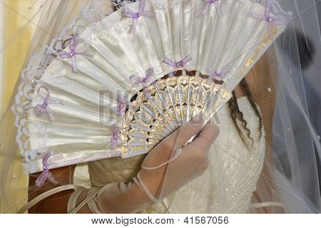 Bride With The White Dress And Fan