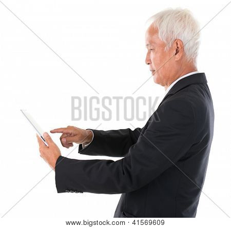 Side view senior adult Asian Chinese boss using tablet computer standing over white background