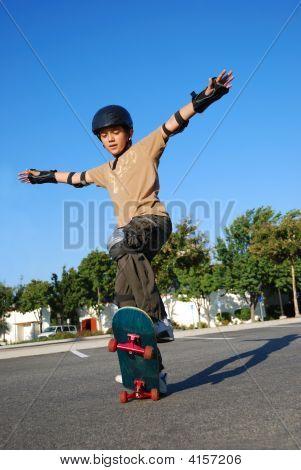 Boy Doing Stunts On A Skateboard