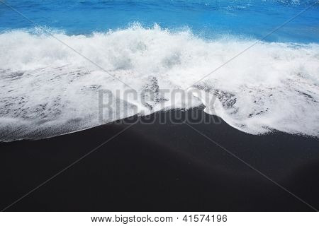 Black sand beach volcanic in Tenerife at Canary Islands