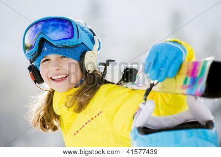 Skiing, winter, teenage girl  - young skier in winter resort