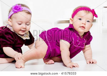Two cute female toddlers playing
