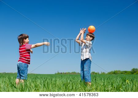 Active kids playing with a ball