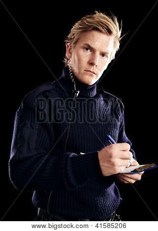 Handsome Police On Duty Writing Something