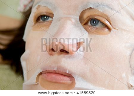 Portrait  Close-up Woman Applying Rejuvenating Facial Mask On Her Face