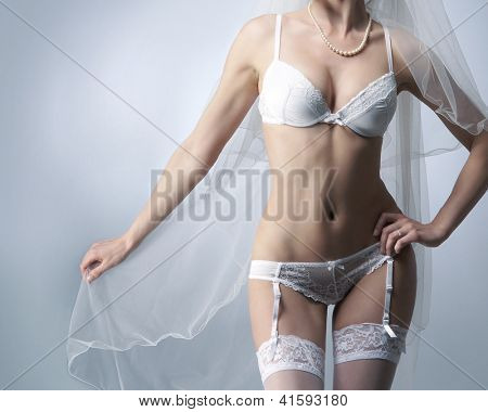 Body of young, beautiful and sexy bride in erotic lingerie