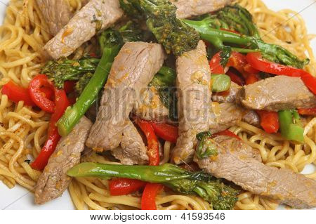 Thai beef and broccoli stirfry with noodles.