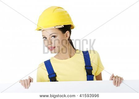 Female construction worker with blank board, isolated on white