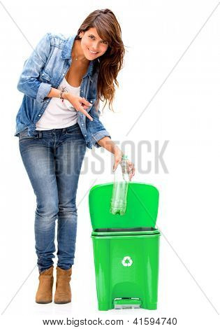 Woman recycling a plastic bottle - isolated over a white background