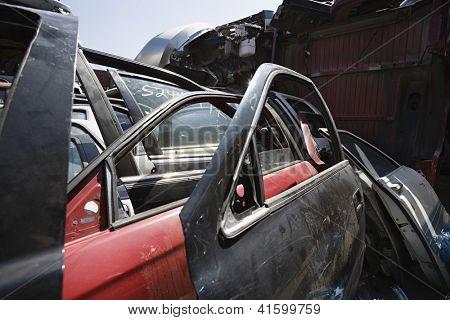 Worn out car parts at scrapyard
