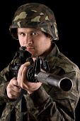 picture of m16  - Watchful soldier aiming m16 in studio - JPG