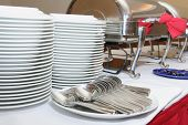 stock photo of chafing  - photograph of plates cutleries and chafing dish at catering buffet - JPG