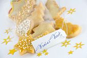 stock photo of weihnachten  - some christmas cookies with a marker tag on which stands handwritten Frohe Weihnachten - JPG