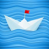 Vector paper boat in blue waves of sea