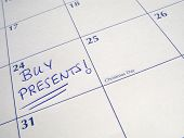 pic of 24th  - Buy presents written on a calendar on the 24th December Christmas Eve - JPG