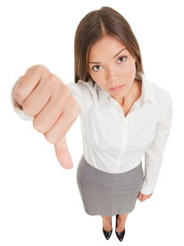 pic of disapproval  - Sad young business woman making a thumbs down sign looking with disapproval background in high angle view in full length - JPG
