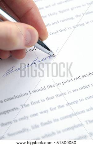 Teacher Grading A Paper