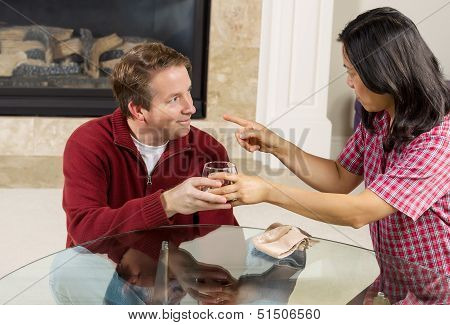 Mature Couple Dealing With Acohol Drinking Problems At Home
