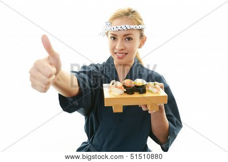Smiling woman with sushi