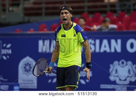 KUALA LUMPUR - SEPTEMBER 27: David Ferrer reacts during a quarter-final match playing Joao Sousa at the Malaysia Open 2013 tennis played at the Putra Stadium, Malaysia on September 27, 2013.