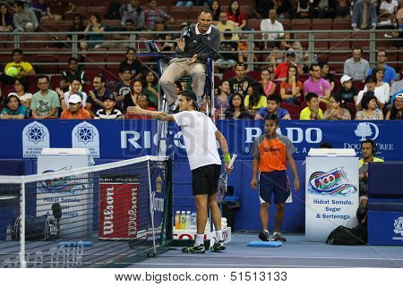 KUALA LUMPUR - SEPTEMBER 27: Joao Sousa argues a line call at his quarter-final match against David Ferrer at the Malaysia Open 2013 tennis played at the Putra Stadium, Malaysia on September 27, 2013.