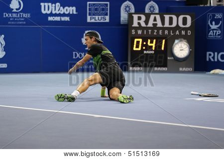 KUALA LUMPUR - SEPTEMBER 28: Joao Sousa falls during his semi-final match against Jurgen Melzer in the Malaysia Open 2013 tennis played at the Putra Stadium, Malaysia on September 28, 2013.