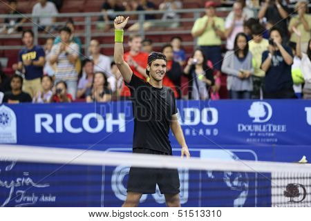 KUALA LUMPUR - SEPTEMBER 28: Joao Sousa defeats Jurgen Melzer in this semi-final match of the Malaysia Open 2013 tennis played at the Putra Stadium, Malaysia on September 28, 2013.