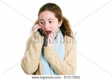 Latina tween teenage girl gossiping with friends on her cellphone.  Isolated on white.