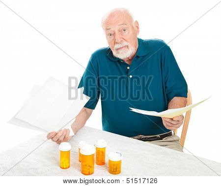 Senior man doesn't know how he will pay all his medical bills.  Isolated on white.