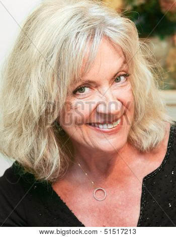 Portrait of a beautiful mature woman in her early sixties.