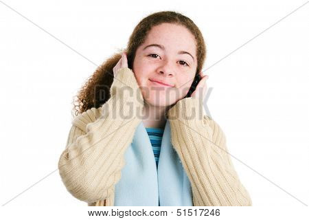 Cute Latina tween teenage girl listening to music on her headphones.  Isolated on white.