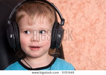Child In Ear-phones