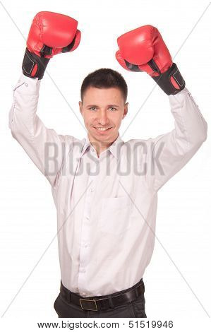 Businessman raised his arms in triumph in boxing gloves