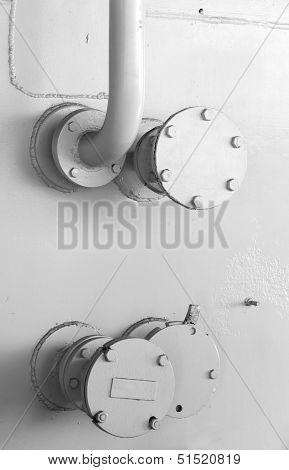 Abstract Industrial Background With White Naval Wall And Fragment Of Tubing
