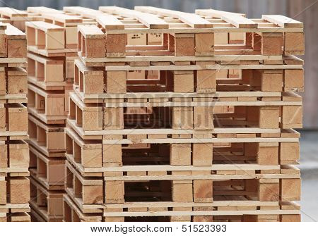 Pile Of Standard Wooden Pallets On A Storage Area