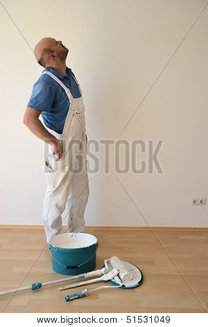 a painter at work on a construction site