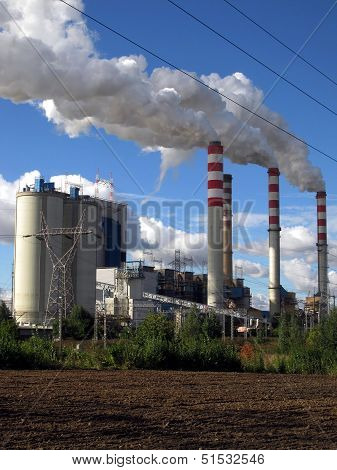 Brown-coal Power Plant With Chimney Giving Off Large Amounts Of Gas