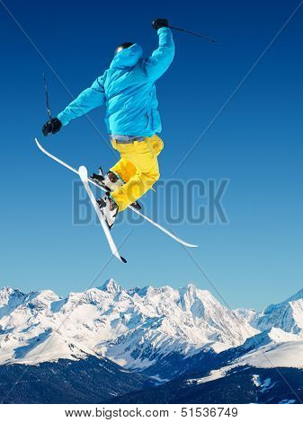 Jumping Skier in high mountains