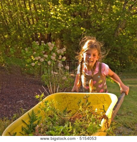 Little Girl Using Yellow Wheelbarrow