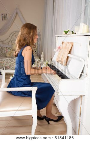 Young Blond Woman Playing The Piano