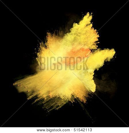 Yellow powder isolated on black background