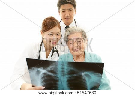 Asian medical staff with old woman