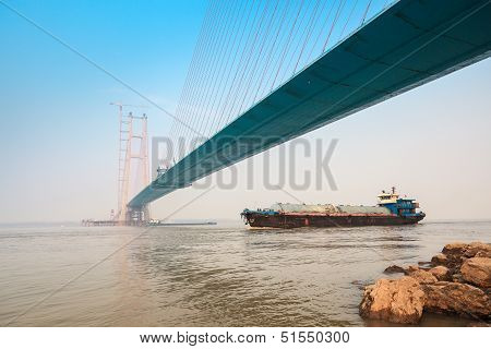 Cargo Ship With Cable Stayed Bridge