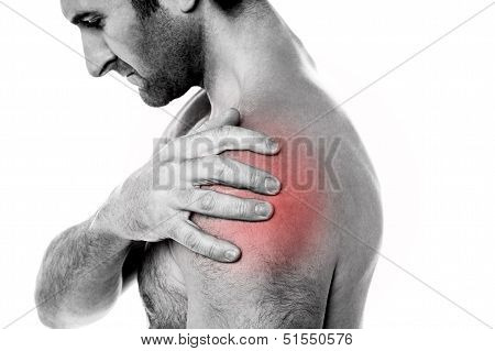 Closeup Of Young Man Having Pain In Shoulder