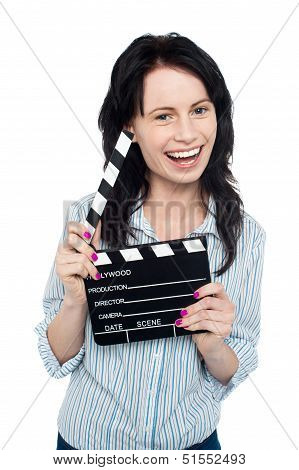 Young Charming Girl Holding Clapperboard