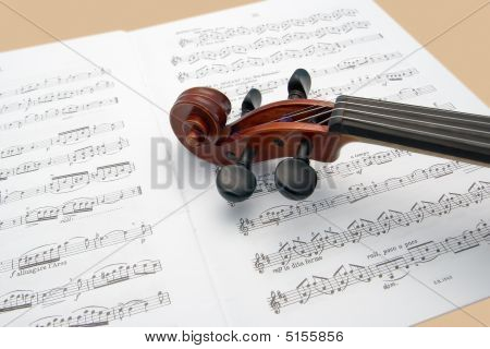 Violin Neck Resting On Sheet Music